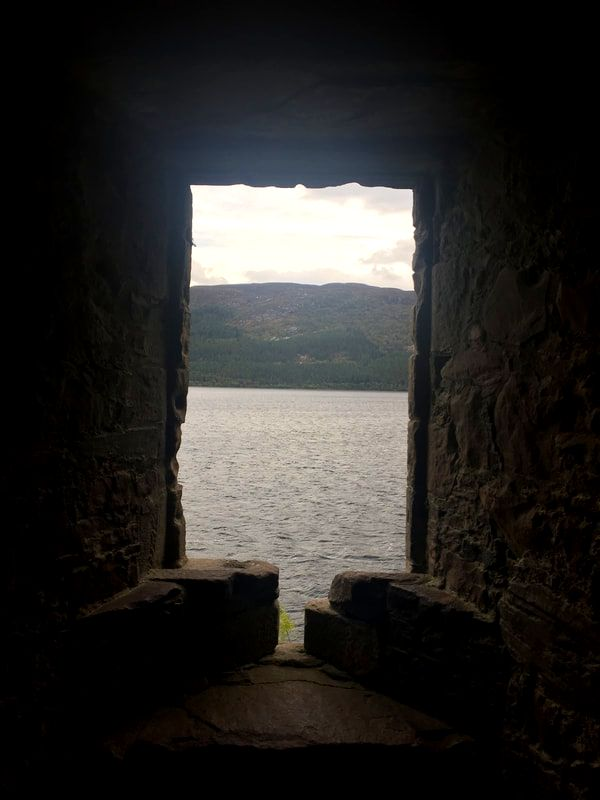 View out of Loch Ness through a window of Urquhart Castle, Loch Ness, Scotland